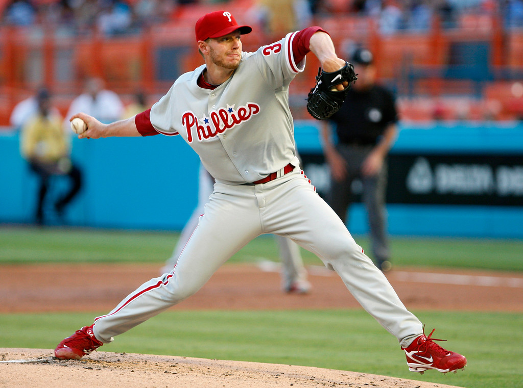 . FILE - This May 29, 2010, file photo shows Philadelphia Phillies\' Roy Halladay throwing a pitch during the first inning, enroute to a perfect game, against the Florida Marlins, in Miami. Halladay unanimously won the NL Cy Young Award, Tuesday, Nov. 16, 2010,  making him the fifth pitcher to earn the honor in both leagues. (AP Photo/Wilfredo Lee, File)