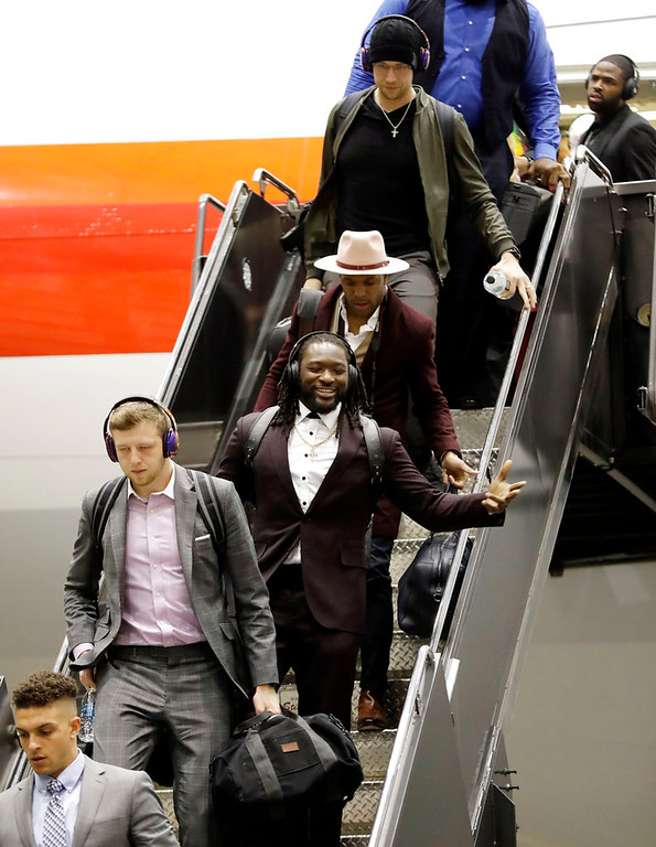 . Philadelphia Eagles quarterback Nate Sudfeld, second from bottom, is followed by running back LeGarrette Blount, linebacker Mychal Kendricks, and quarterback Nick Foles, as they arrive for the NFL Super Bowl 52 football game Sunday, Jan. 28, 2018, in Minneapolis. Philadelphia is scheduled to face the New England Patriots. (AP Photo/Eric Gay)