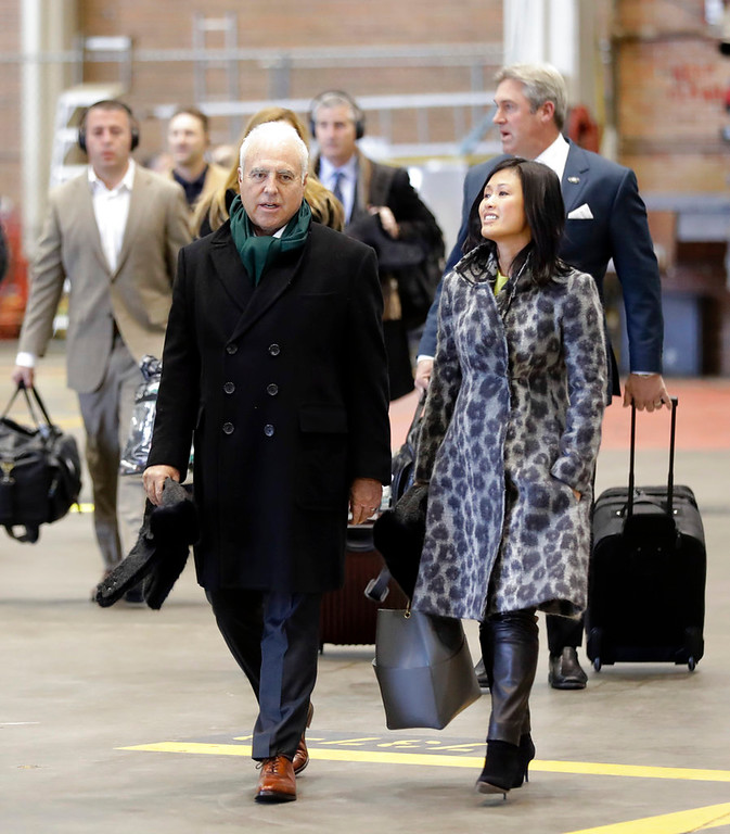 . Philadelphia Eagles owner Jeffrey Lurie, left, and his wife, Tina Lai, right, arrive with the team for the NFL Super Bowl 52 football game Sunday, Jan. 28, 2018, in Minneapolis. Philadelphia is scheduled to face the New England Patriots. (AP Photo/Eric Gay)
