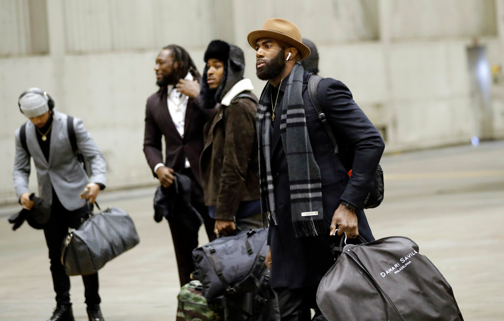 . Philadelphia Eagles strong safety Malcolm Jenkins, front, arrives with teammates for the NFL Super Bowl 52 football game Sunday, Jan. 28, 2018, in Minneapolis. Philadelphia a a scheduled to face the New England Patriots. (AP Photo/Eric Gay)
