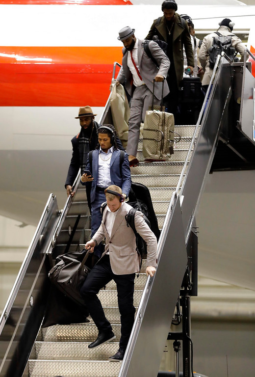 . Injured Philadelphia Eagles quarterback Carson Wentz, front, arrives with his teammates for the NFL Super Bowl 52 football game Sunday, Jan. 28, 2018, in Minneapolis. Philadelphia a a scheduled to face the New England Patriots. (AP Photo/Eric Gay)