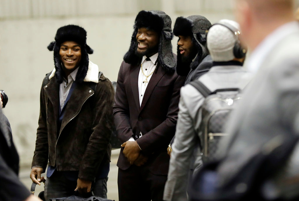 . Philadelphia Eagles running back Corey Clement, left, and running back LeGarrette Blount, center, arrive with teammates for the NFL Super Bowl 52 football game Sunday, Jan. 28, 2018, in Minneapolis. Philadelphia a a scheduled to face the New England Patriots. (AP Photo/Eric Gay)