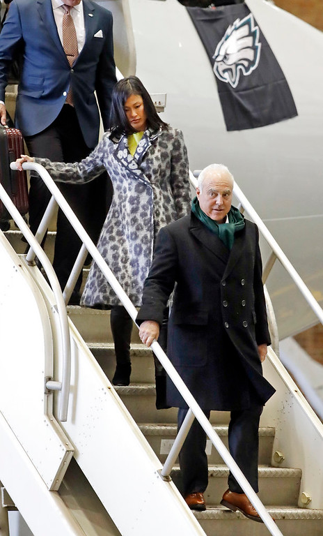. Philadelphia Eagles owner Jeffrey Lurie is followed by his wife, Tina Lai, as the team arrives for the NFL Super Bowl 52 football game Sunday, Jan. 28, 2018, in Minneapolis. The Eagles are scheduled to face the New England Patriots Feb. 4.(AP Photo/Mark Humphrey)