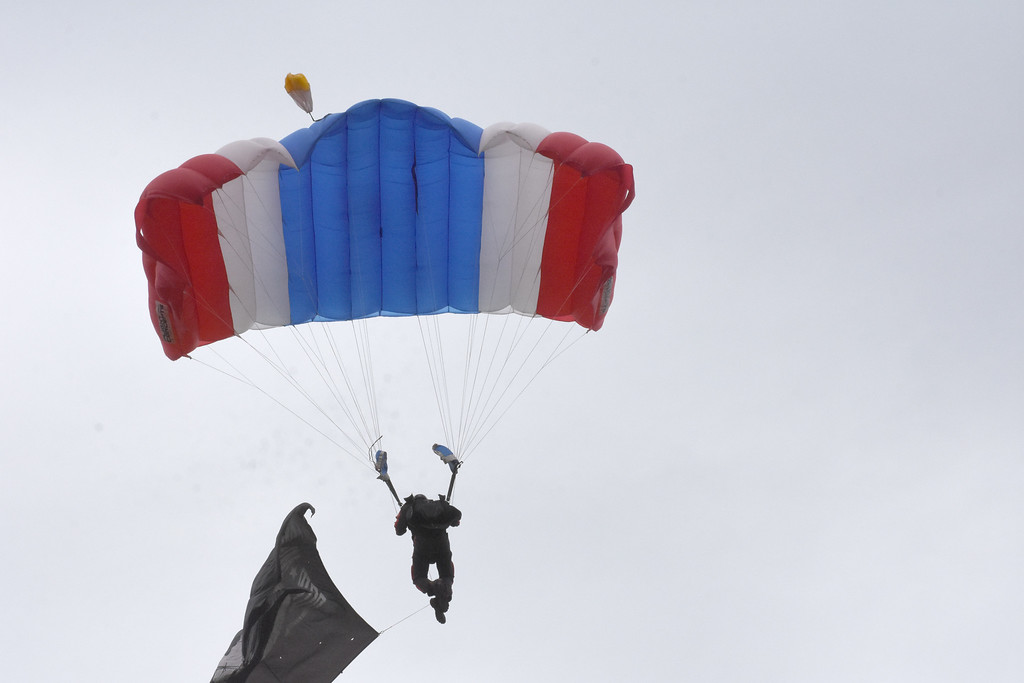. Sgt. First Class Ryan O\'Rourke parachutes into Rose Tree Park with a POW flag. He is part of the All Veteran Group Skydivers.