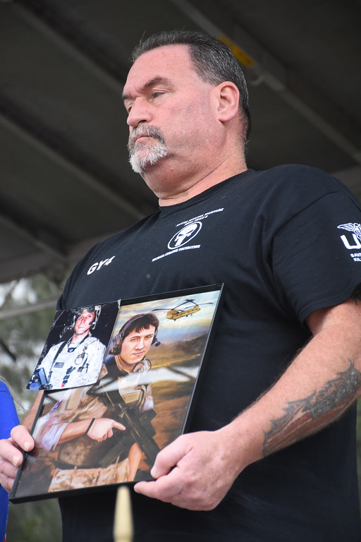 . Holding up a picture of his son, Michael Strange, a US Navy Seal who died in Afghanistan talks about how it feels to be a Gold Star Father and has started the Michael Strange Foundation for people who have lost loved ones in the military.