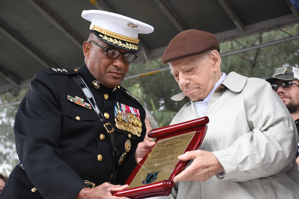 . Retired General Ronald Coleman, USMC, a native of Darby, presents an award of appreciation to World War II veteran Joseph Cassizzi of Drexel Hill. He is 96 years old.