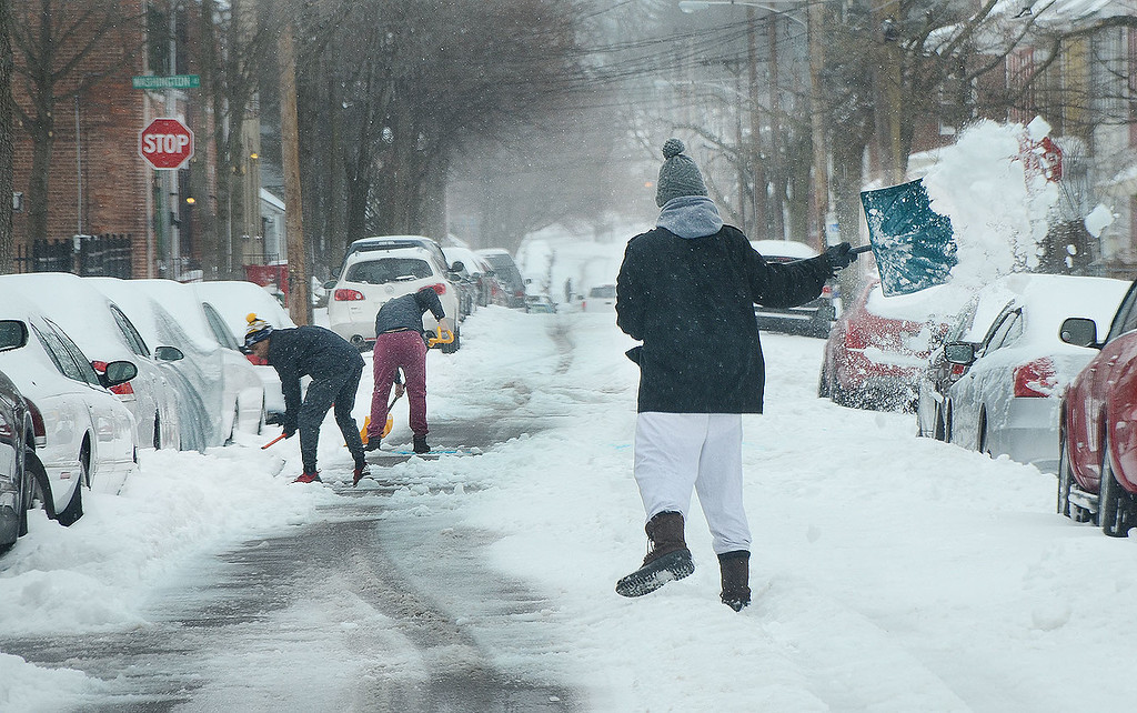 . A man shovels out a car in the 400 block of Chestnut St. in Pottstown during Tuesday\'s snow storm...Photo/Tom Kelly III