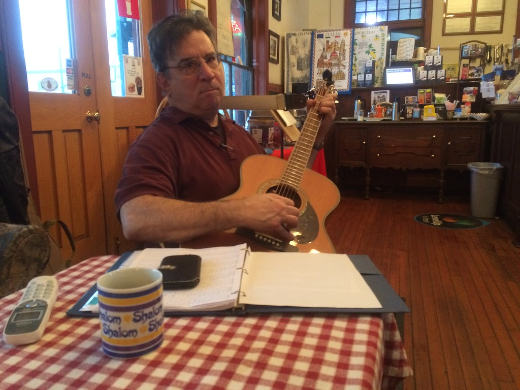 . A slow day at station cafe in Wayne train station so Mike Lefkowitz brought his guitar