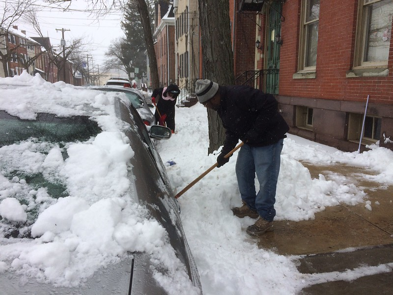 Leighton Dobson and Lorna McIntosh dig out their cars on King Street<br /> in Pottstown Tuesday. Photo by Evan Brandt