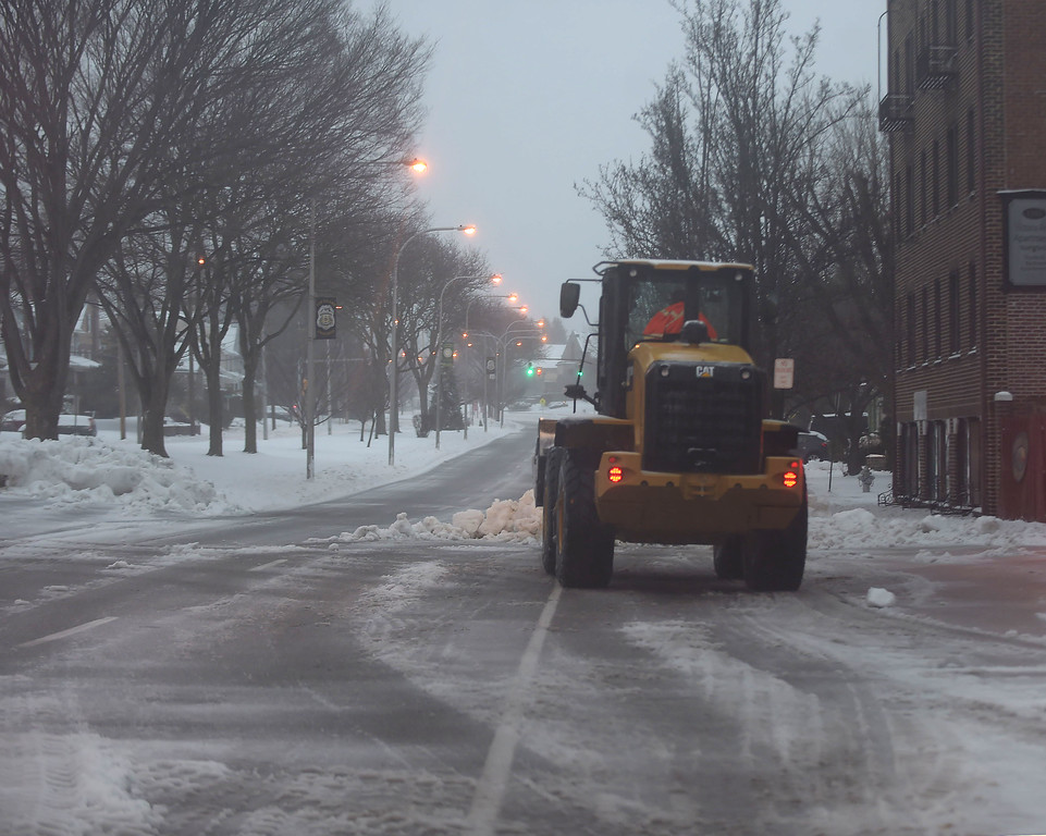 . PETE  BANNAN-DIGITAL FIRST MEDIA     A Haverford Township loader clears snow in front of Brookline Fire station Tuesday morning. THe Township declared a snow emergency to make clearing the roads easier.