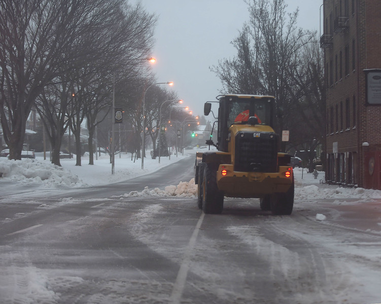 PETE  BANNAN-DIGITAL FIRST MEDIA     A Haverford Township loader clears snow in front of Brookline Fire station Tuesday morning. THe Township declared a snow emergency to make clearing the roads easier.