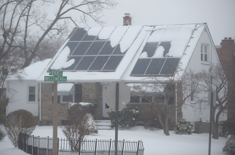 PETE  BANNAN-DIGITAL FIRST MEDIA    Snow and sleet cover the solar panels on this Havertown houseTuesday morning. The Nor'easter closed schools and business across the Delaware Valley.