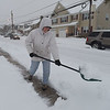 PETE  BANNAN-DIGITAL FIRST MEDIA     Deb Olszewski clears snow from in front of her Havertown home Tuesday morning March 14, 2017.  Olszewski said she enjoys getting out early to stay ahead of the storm.