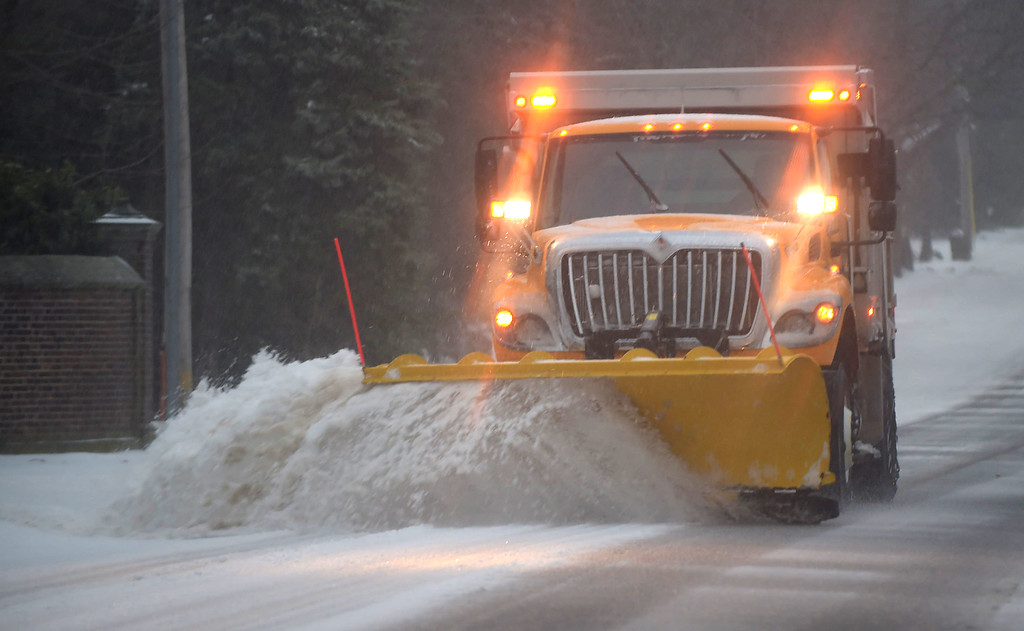 . PETE  BANNAN-DIGITAL FIRST MEDIA      A Lower Merion plow truck clears Montgomery Ave. in Haverford Tuessday morning. With the lighter that predicted totals crews were able to stay ahead of the storm.