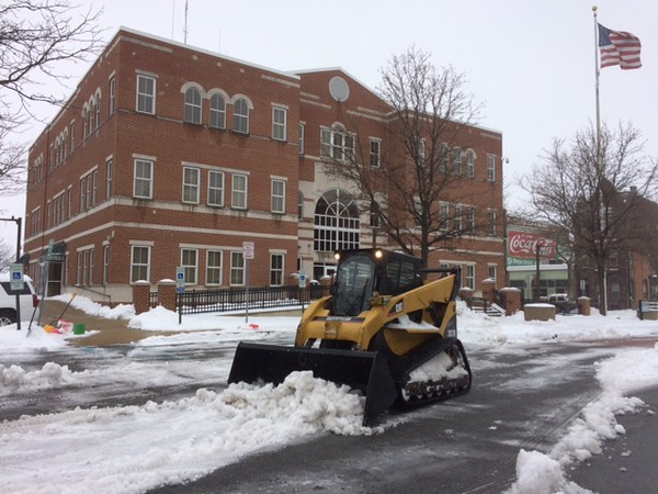 Heavy equipment was brought in to help clear the parking lot in front of Pottstown's Borough Hall. Photo by Evan Brandt
