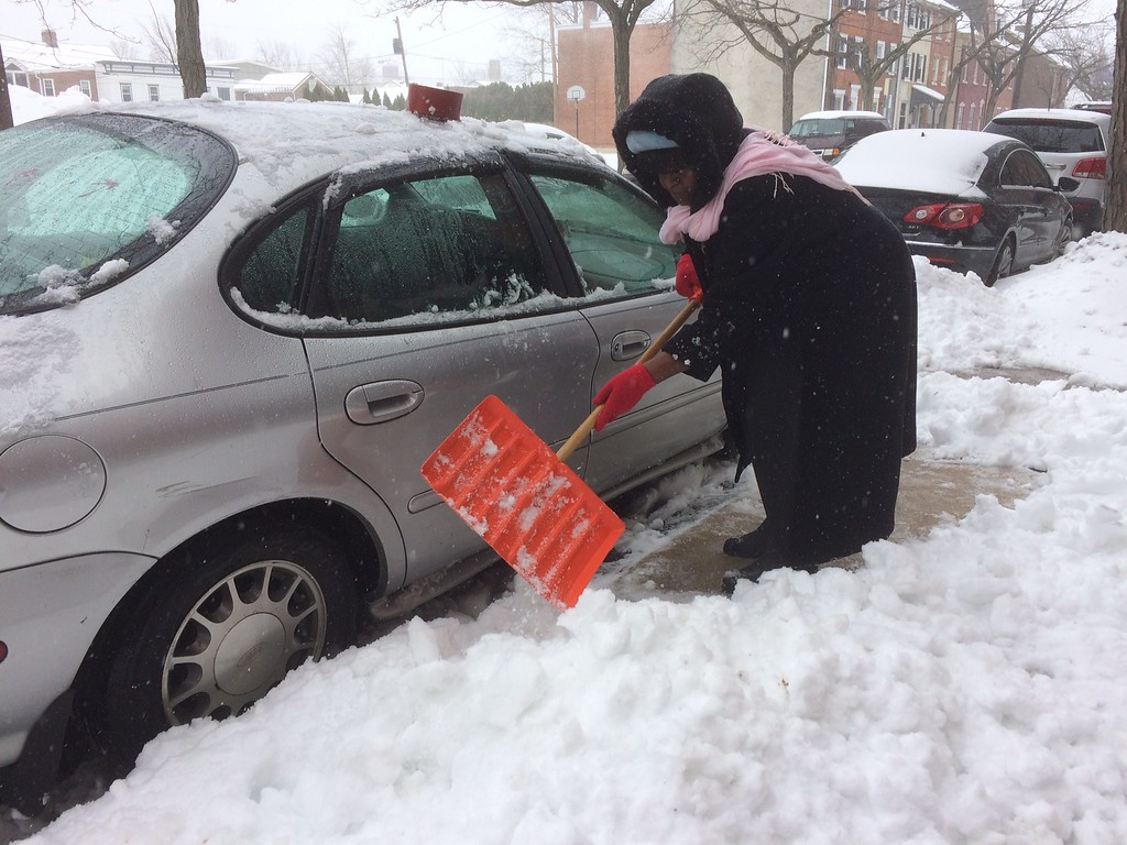 . Lorna McIntosh digs out her car in on King Street in Pottstown. Photo by Evan Brandt
