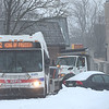 PETE  BANNAN-DIGITAL FIRST MEDIA     A SEPTA plow truck attempts to clear a path for this bus to back up after it was stuck in snow at the Paoli train station Tuesday morning. Few people ventured out making for light numbers on the regional rail.