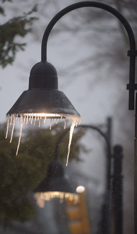 . PETE  BANNAN-DIGITAL FIRST MEDIA    Icicles hang from a light at the Wayne train station Tuesday morning.