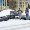 Three guys watch as Brooke Kissinger shovels out her car on High St. near Price St. in Pottstown during Tuesday's snow storm. In defense of the guys...Brooke says she likes to shovel snow and besides the guys were out earlier shoveling and they were taking a break.....Photo/Tom Kelly III
