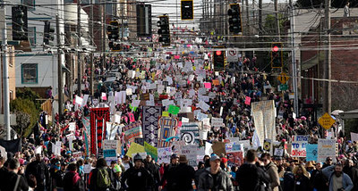 . EDS NOTE: GRAPHIC LANGUAGE- Tens of thousands of demonstrators fill a street headed toward downtown during a women\'s march Saturday, Jan. 21, 2017, in Seattle. Women across the Pacific Northwest marched in solidarity with the Women\'s March on Washington and to send a message in support of women\'s rights and other causes. (AP Photo/Elaine Thompson)