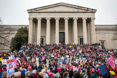 . Demonstrators wait for the march to begin Saturday, Jan. 21, 2017 on the National Mall during the Women\'s March on Washington. (Brian Cassella/Chicago Tribune via AP)