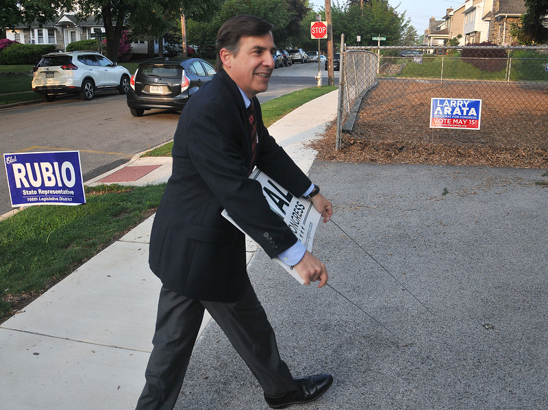PETE  BANNAN-DIGITAL FIRST MEDIA        Greg Vitali sets out campaign signs in front of the polls at Brookline School in Haverford Tueday.