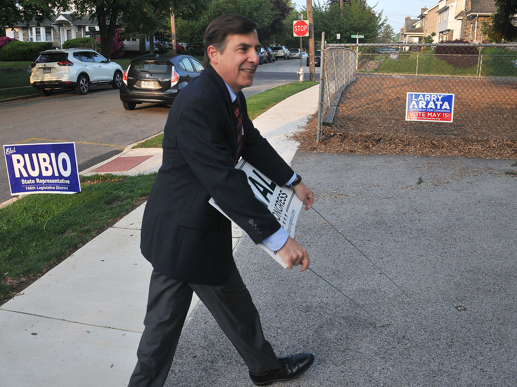 . PETE  BANNAN-DIGITAL FIRST MEDIA        Greg Vitali sets out campaign signs in front of the polls at Brookline School in Haverford Tueday.