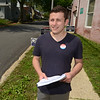 PETE  BANNAN-DIGITAL FIRST MEDIA          Kevin Carson hands out campaign information outside West Chester Ward 4 at the  public works center. Carson graduated from West Chester University Sunday and is running to be a Democratic commettie person. It was a slow morning there had only been 14 voters by 11 a.m. Tuesday.