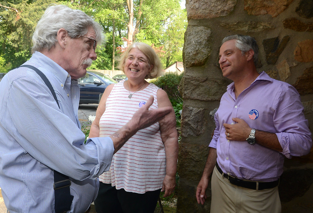 . PETE  BANNAN-DIGITAL FIRST MEDIA       Voter Tom McManus talks with Radnor Commissioner candidates Jane Galland Sean Farhy at Radnor Methodist church. Voters had to use a separate machine to vote for that election.
