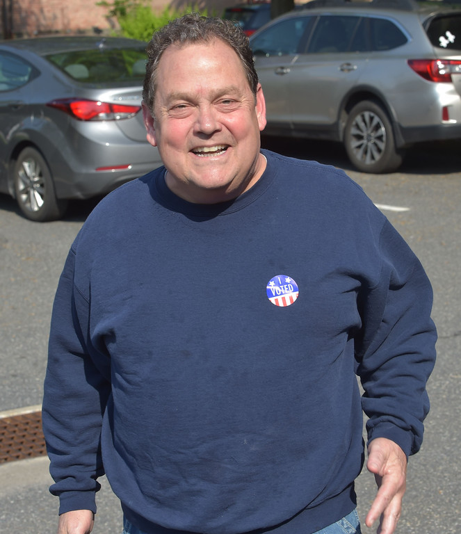 ". PETE  BANNAN-DIGITAL FIRST MEDIA       Jeff Mattero happily displays his ""I Voted \"" sticker after visiting the polls at Upper Providence District 2 in the township building Tuesday morning."