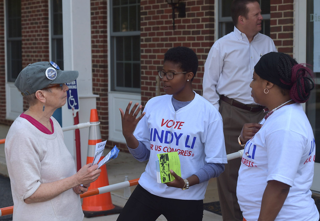 . PETE  BANNAN-DIGITAL FIRST MEDIA       Mary Gay Scanlon supporter, Andrea Knox talks with  Linny Li supports Juda Erwin and April Wright outside the Upper Providence Township building Tuesday morning.