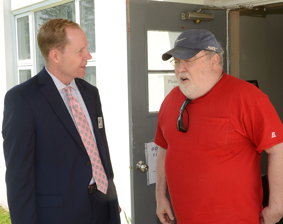 . PETE  BANNAN-DIGITAL FIRST MEDIA          Pennsylvania State Rep. Duane Milne speaks with Richard Burcik at the Malven polling place at Malvern Baptist Church Tuesday afternon.