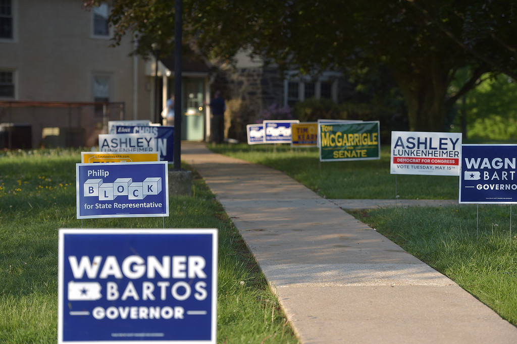 . PETE  BANNAN-DIGITAL FIRST MEDIA         Campaign signs line the walk at Rose Tree Park Tueday, primary day in Pennsylvania.