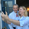 PETE  BANNAN-DIGITAL FIRST MEDIA        Larry and Heather Arata pose for a selfie in front of the polls at Brookline School in Haverford Tueday morning.