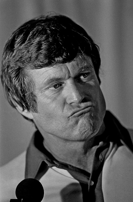 . Philadelphia Eagles head coach Dick Vermeil ponders a question in the team\'s lockerroom after their loss to the Oakland Raiders in Super Bowl XV in New Orleans Sunday, Jan. 25, 1981. (AP Photo/John Filo)