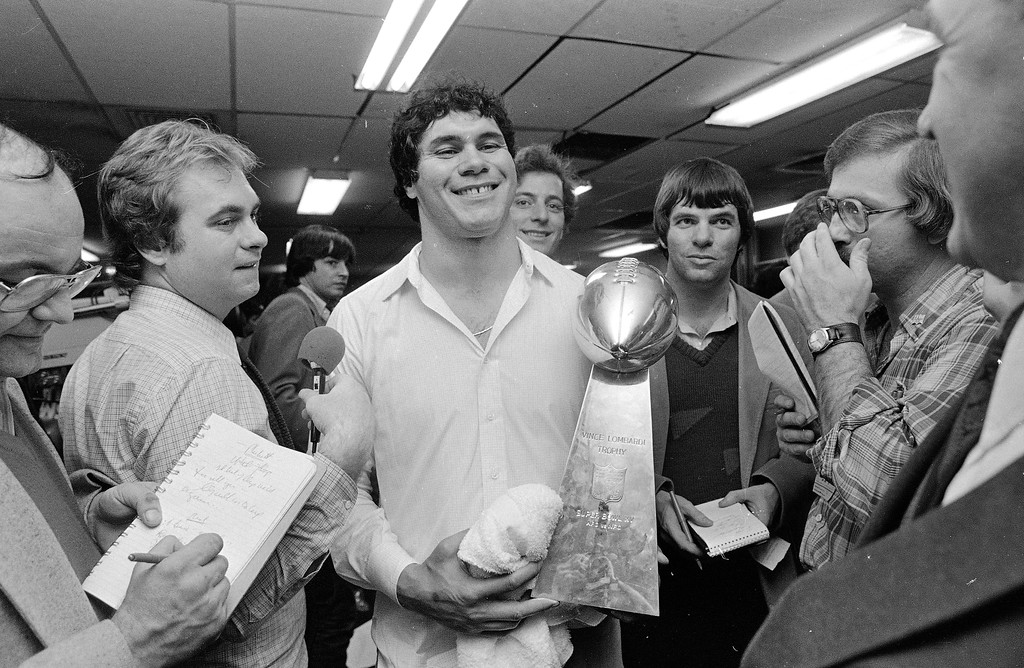 . Oakland Raiders\' quarterback Jim Plunkett smiles broadly as he shows off his Most Valuable Player trophy after being named as the top competitor in Super Bowl XV in New Orleans against the Philadelphia Eagles, Jan. 25, 1981.  (AP Photo)