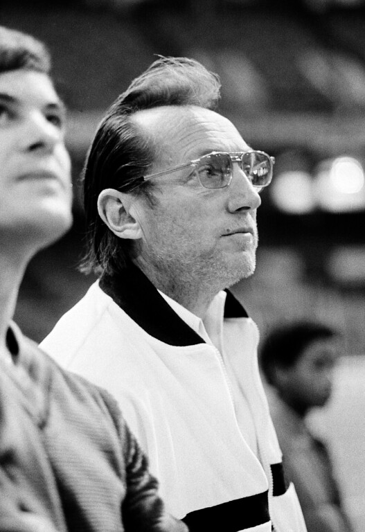 . Oakland Raiders general managing partner Al Davis, sporting several days growth of beard, watches his team go through a practice session in the Superdome in New Orleans Saturday as they went through final preparations for Sunday\'s Super Bowl XV match with the Philadelphia Eagles January 24, 1981. Davis has continued his battle with NFL Commissioner Pete Rozelle into Super Bowl week, with both men trading shots. (AP Photo/Paul Sakuma)