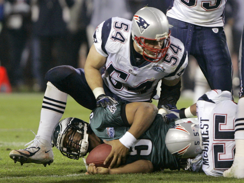 . Philadelphia Eagles quarterback Donovan McNabb is sacked by New England Patriots defenders Tedy Bruschi (54) and Willie McGinest (55) in the third quarter of Super Bowl XXXIX at Alltel Stadium on Sunday, Feb. 6, 2005, in Jacksonville, Fla. (AP Photo/Rusty Kennedy)