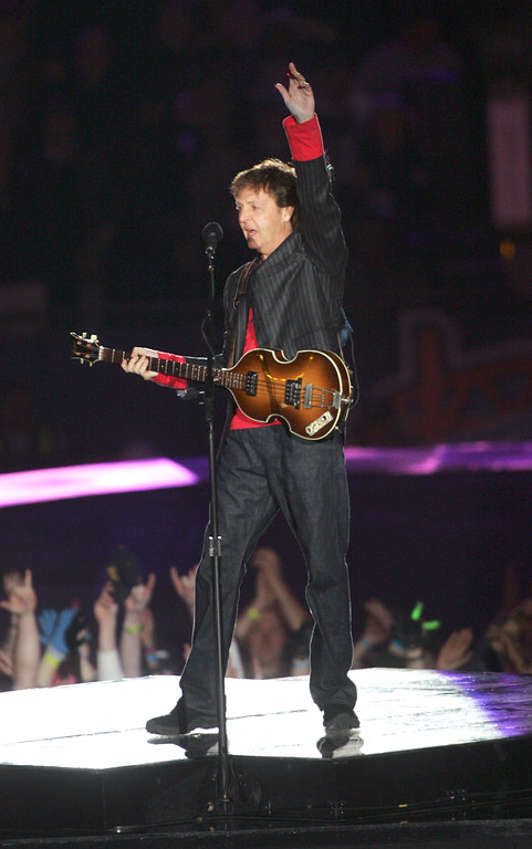 . Musician Paul McCartney performs during the halftime show at Super Bowl XXXIX between the New England Patriots and Philadelphia Eagles, Sunday, Feb. 6, 2005, at Alltel Stadium in Jacksonville, Fla. (AP Photo/Phil Coale)