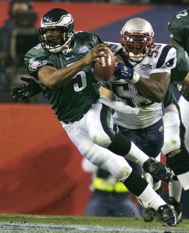 . Philadelphia Eagles quarterback Donovan McNabb is chased by New England Patriots linebacker Rosevelt Colvin in the first quarter of Super Bowl XXXIX at Alltel Stadium on Sunday, Feb. 6, 2005, in Jacksonville, Fla. (AP Photo/Gene J. Puskar)