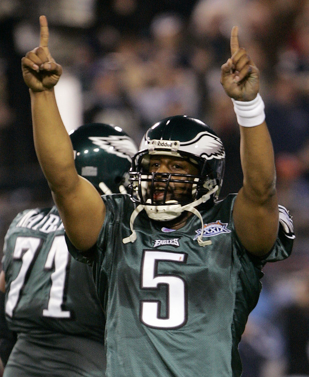 . Philadelphia Eagles quarterback Donovan McNabb celebrates after throwing a 6-yard touchdown pass to tight end L.J. Smith in the second quarter against the New England Patriots during Super Bowl XXXIX at Alltel Stadium on Sunday, Feb. 6, 2005, in Jacksonville, Fla.. (AP Photo/Rusty Kennedy)