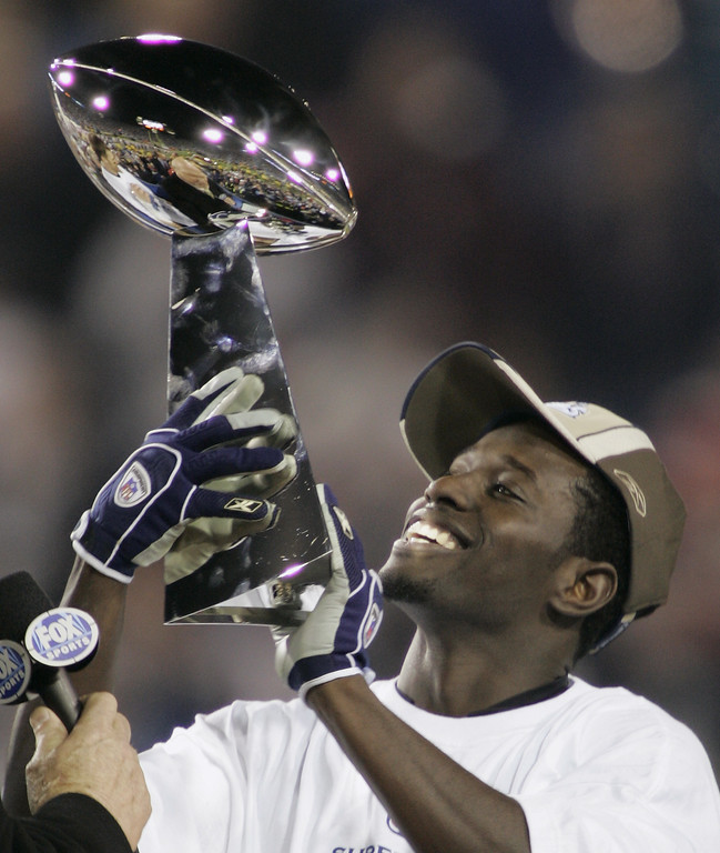 . Super Bowl XXXIX Most Valuable Player Deion Branch of the New England Patriots holds up the Vince Lombardi trophy after the Patriots beat the Philadelphia Eagles, 24-21 in Jacksonville, Fla., Sunday, Feb. 6, 2005. (AP Photo/Chris O\'Meara)
