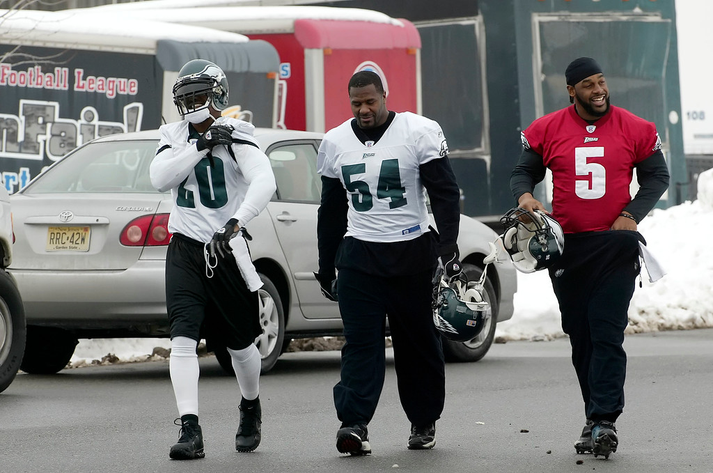 . Philadelphia Eagles free safety Brian Dawkins (20), linebacker Jeremiah Trotter (54) and quarterback Donovan McNabb walk to practice Wednesday, Jan 26, 2005, in Philadelphia.   The Eagles, will play the New England Patriots in  the Super Bowl.on Feb. 6.