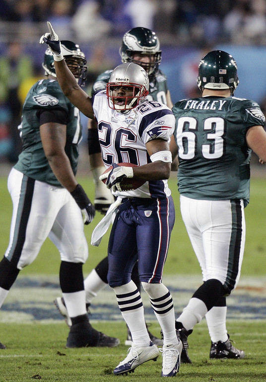 . New England Patriots free safety Eugene Wilson (26) celebrates a second quarter fumble recovery from Philadelphia Eagles center Hank Fraley (63) during Super Bowl XXXIX at Alltel Stadium in Jacksonville, Fla., on Sunday, Feb. 6, 2005. (AP Photo/Amy Sancetta)