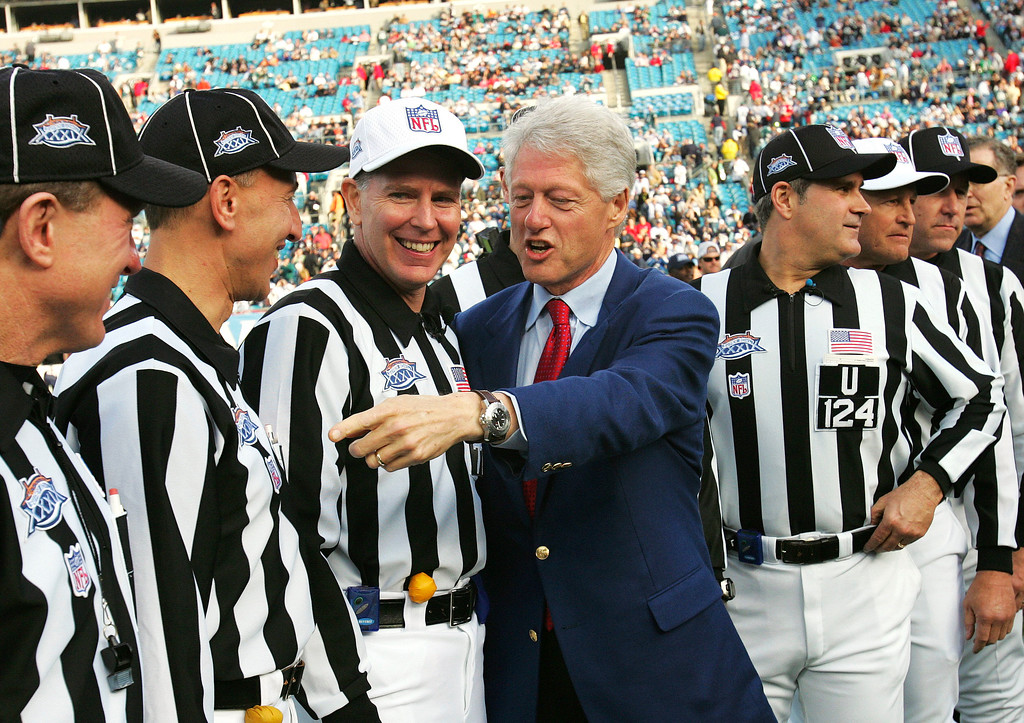 . Former President Bill Clinton talks with the referee crew before the start of Super Bowl XXXIX between the New England Patriots and Philadelphia Eagles at Alltel Stadium on Sunday, Feb. 6, 2005, in Jacksonville, Fla. (AP Photo/David J. Phillip)