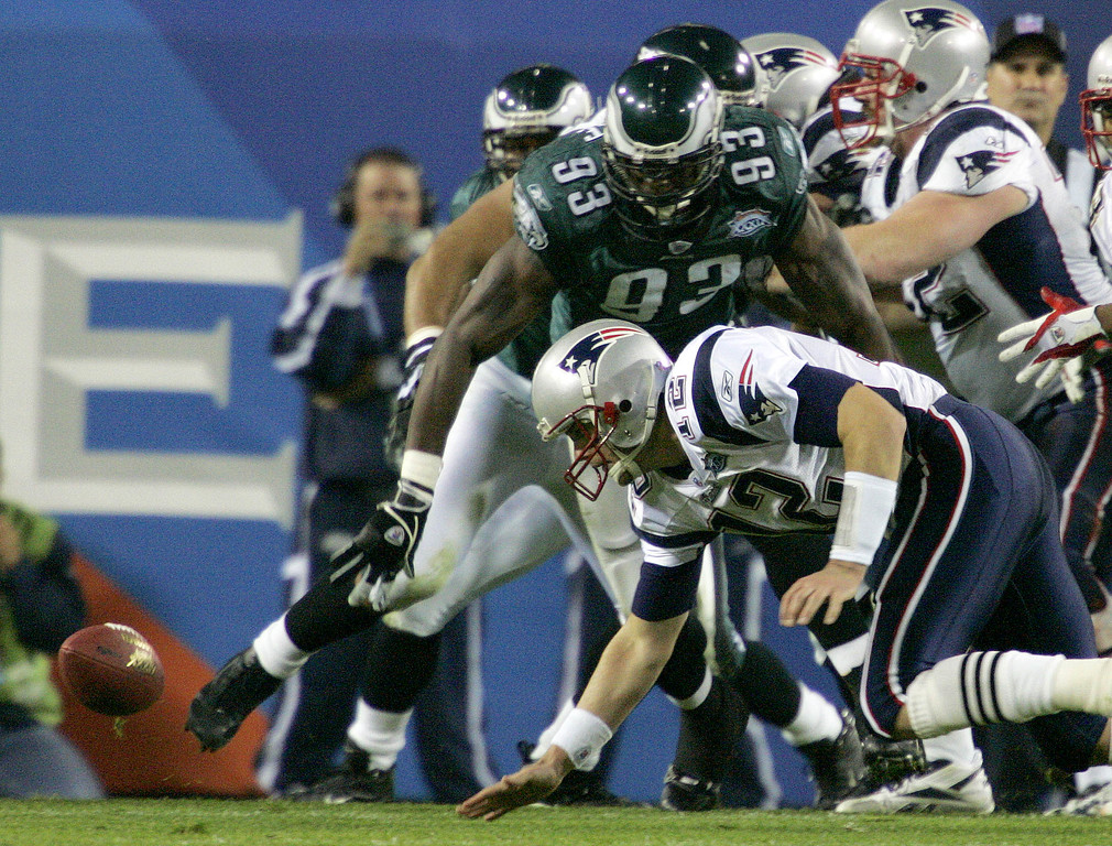. New England Patriots quarterback Tom Brady fumbles the ball as Philadelphia Eagles defensive end Jevon Kearse (93) moves in on the play during the second quarter of Super Bowl XXXIX at Alltel Stadium on Sunday, Feb. 6, 2005, in Jacksonville, Fla. The Eagles recovered the fumble. (AP Photo/Gene J. Puskar)