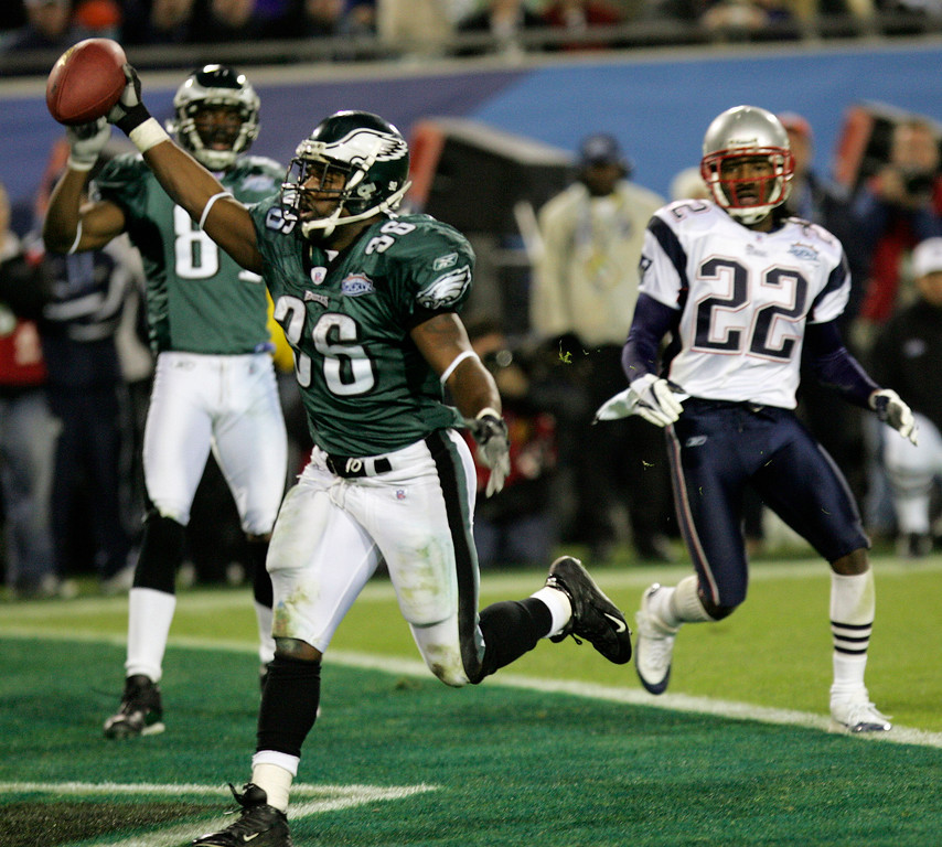 . Philadelphia Eagles running back Brian Westbrook celebrates his 10-yard touchdown reception in the third quarter against the New England Patriots during Super Bowl XXXIX at Alltel Stadium on Sunday, Feb. 6, 2005, in Jacksonville, Fla. Watching at right is the Patriots\' Asante Samuel (22).  (AP Photo/David J. Phillip)