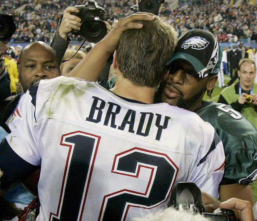 . New England Patriots quarterback Tom Brady is congratulated by Philadelphia Eagles quarterback Donovan McNabb after the Patriots won 24-21 in Super Bowl XXXIX at Alltel Stadium on Sunday, Feb. 6, 2005, in Jacksonville, Fla. (AP Photo/Elaine Thompson)