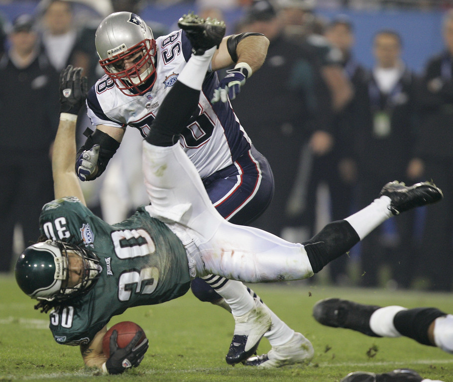 . Philadelphia Eagles\' J.R. Reed (30) is upended on a kickoff return in the fourth quarter as New England Patriots\' Matt Chatham closes in during Super Bowl XXXIX in Jacksonville, Fla., Sunday, Feb. 6, 2005. The Patriots beat the Eagles, 24-21.  (AP Photo/Chris O\'Meara)