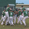PETE  BANNAN-DIGITAL FIRST MEDIA      Ridley Area players celebrate their 13-7 victory over Aston Middletown in the deciding game of the District 19 Little League Majors tournament Tuesday evening.